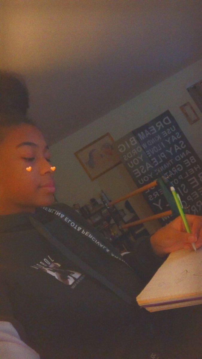 Sophmore Jordan Gilmore doing her homework in her room.
