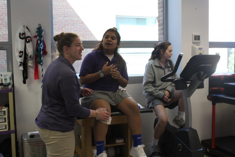 Beth Hagler helps juniors in the training room.