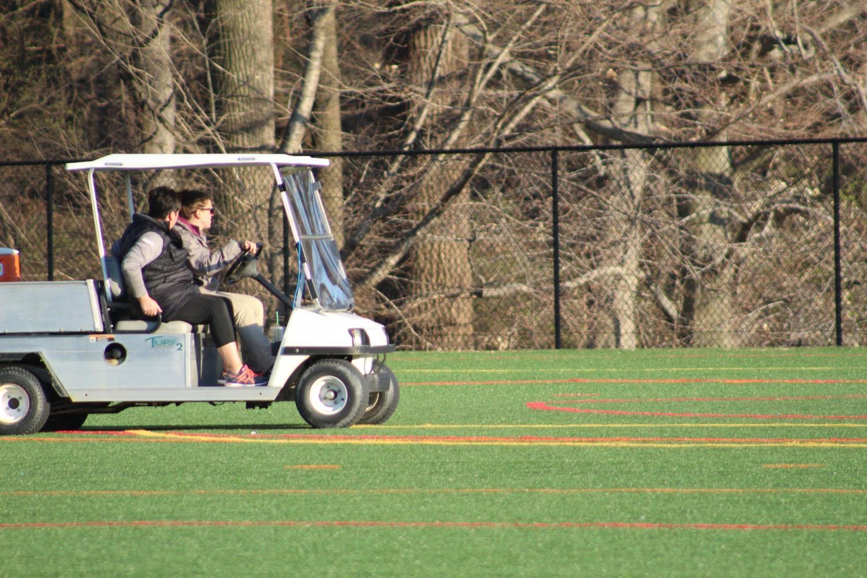Beth Hagler zooms across the turf in her golf cart.