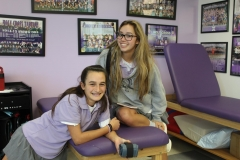 Junior Ellie Walsh and freshman Paige D'Albora in the training room after school.