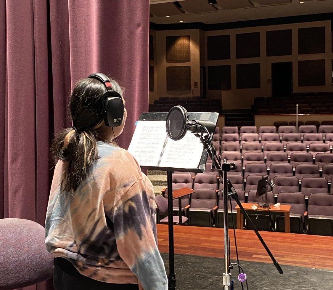 Senior Noelia Villafane recording her part as Charlie Brown.