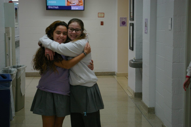 Freshman and Senoir Hugging in the Hallways