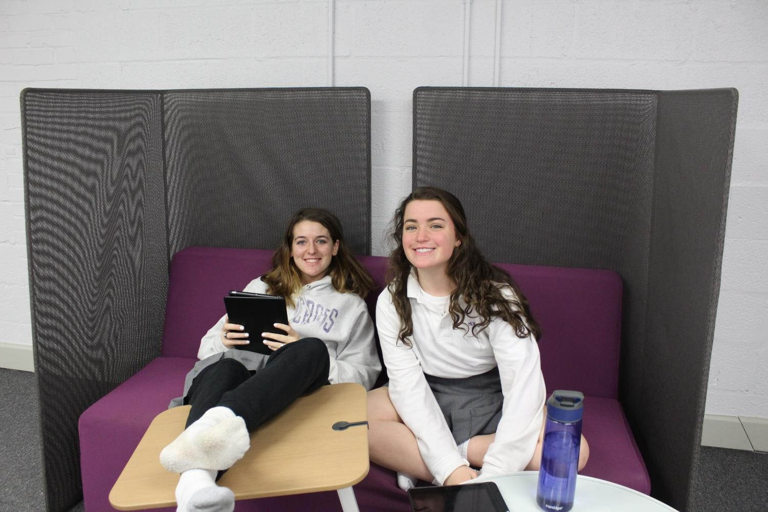 Izzy Mitchell and Annie Malouf study hard in the tech lounge.