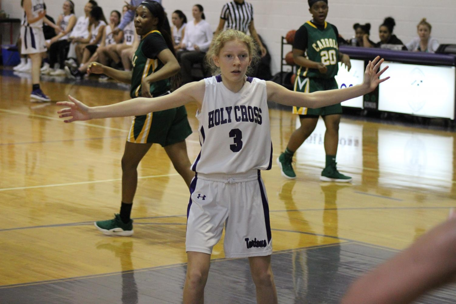 Freshman Ella Burke defends at home against Carroll in the JV game.