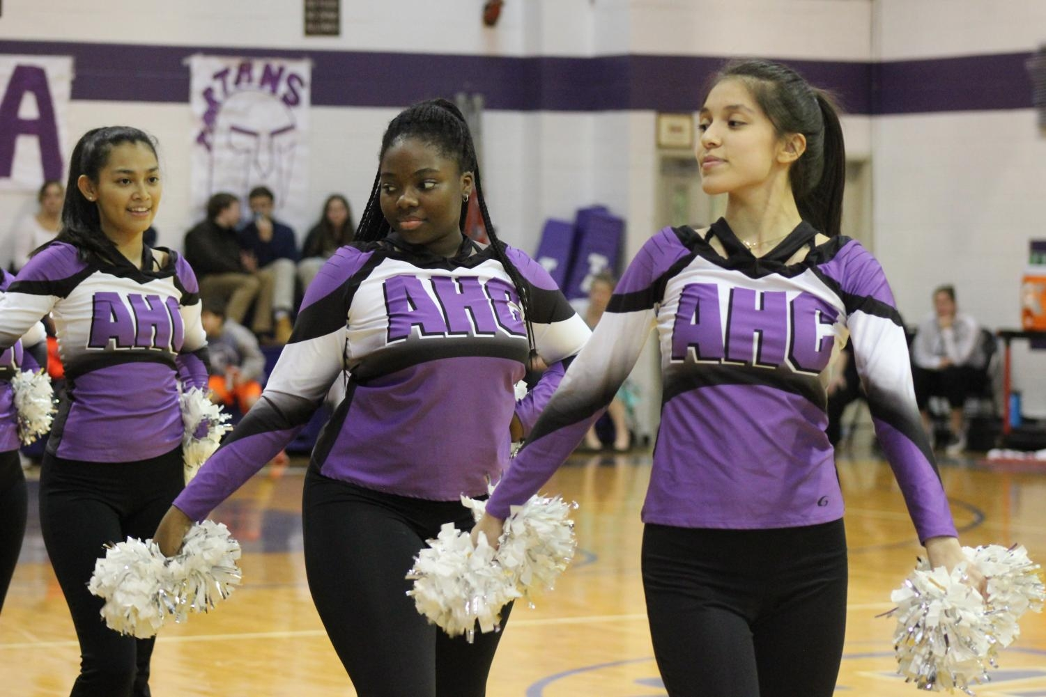 The poms team wows during halftime of the varsity basketball game.
