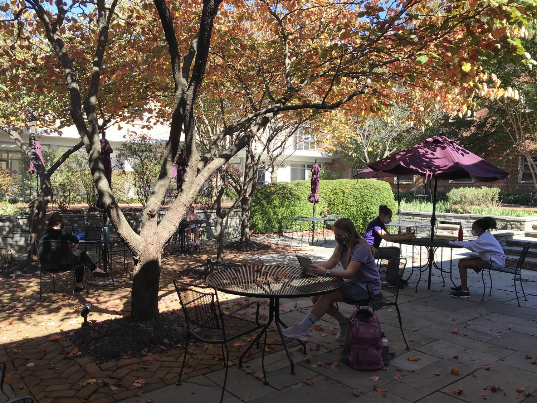 Freshman English class works outside in the senior courtyard.