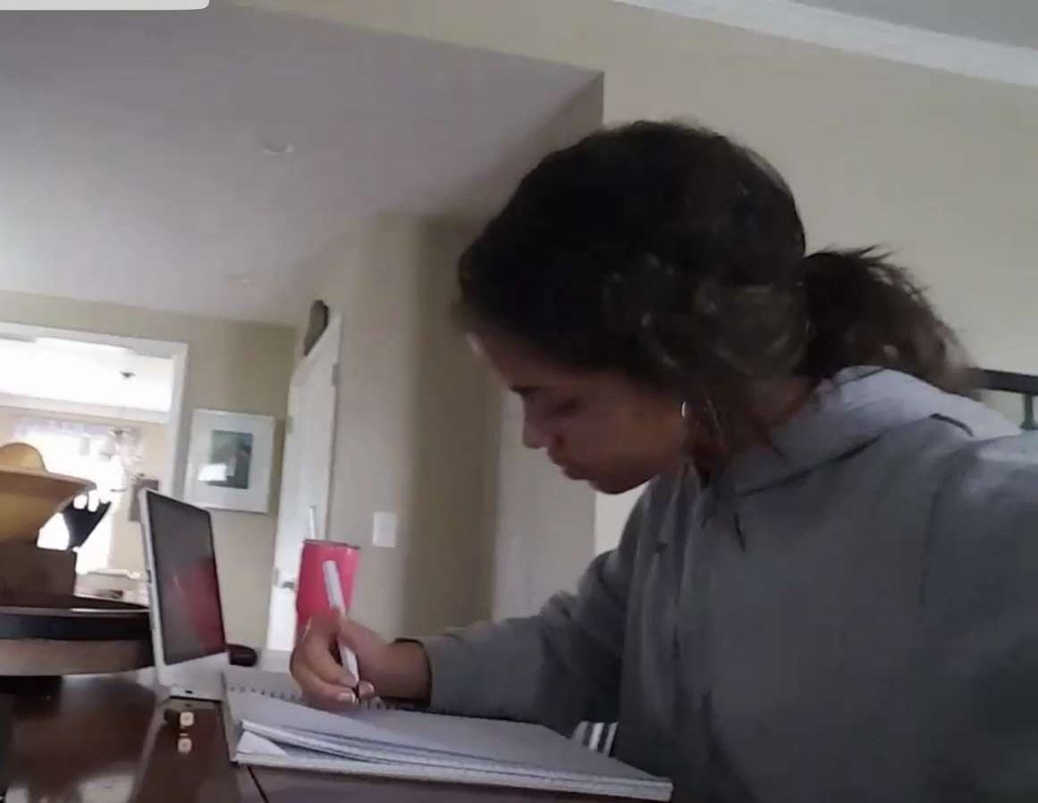 Junior Sophia Skinner is working on a poem that she is writing for her poetry group.