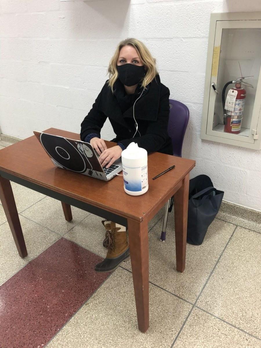 Music teacher Laura Meehan monitoring the halls