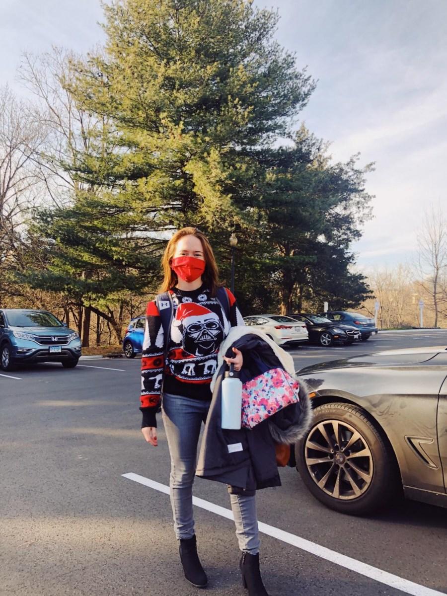 Theology teacher Erica Mullikin is representing her amazing Darth Vader sweater