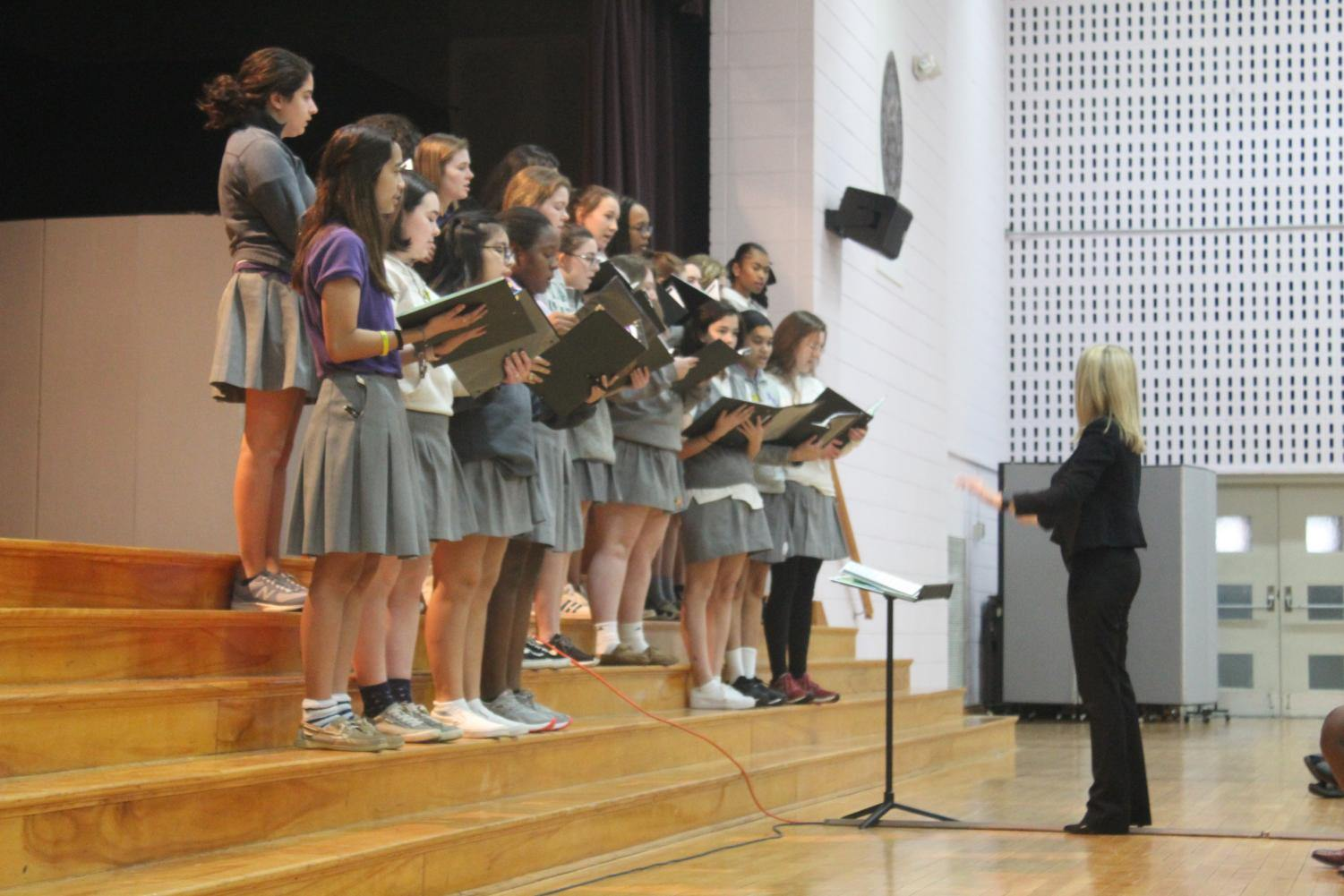 The choir performed for Immaculee and the entire school.