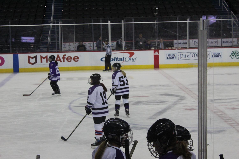 ice hockey players skating on the ice