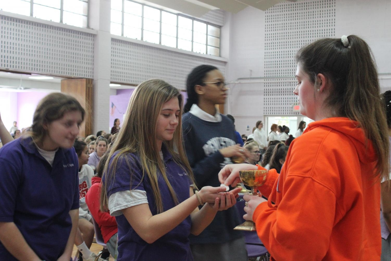 Freshmen Caleigh Rose receiving communion