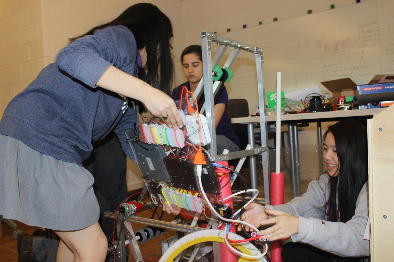 Robotics Club putting together their robot.
