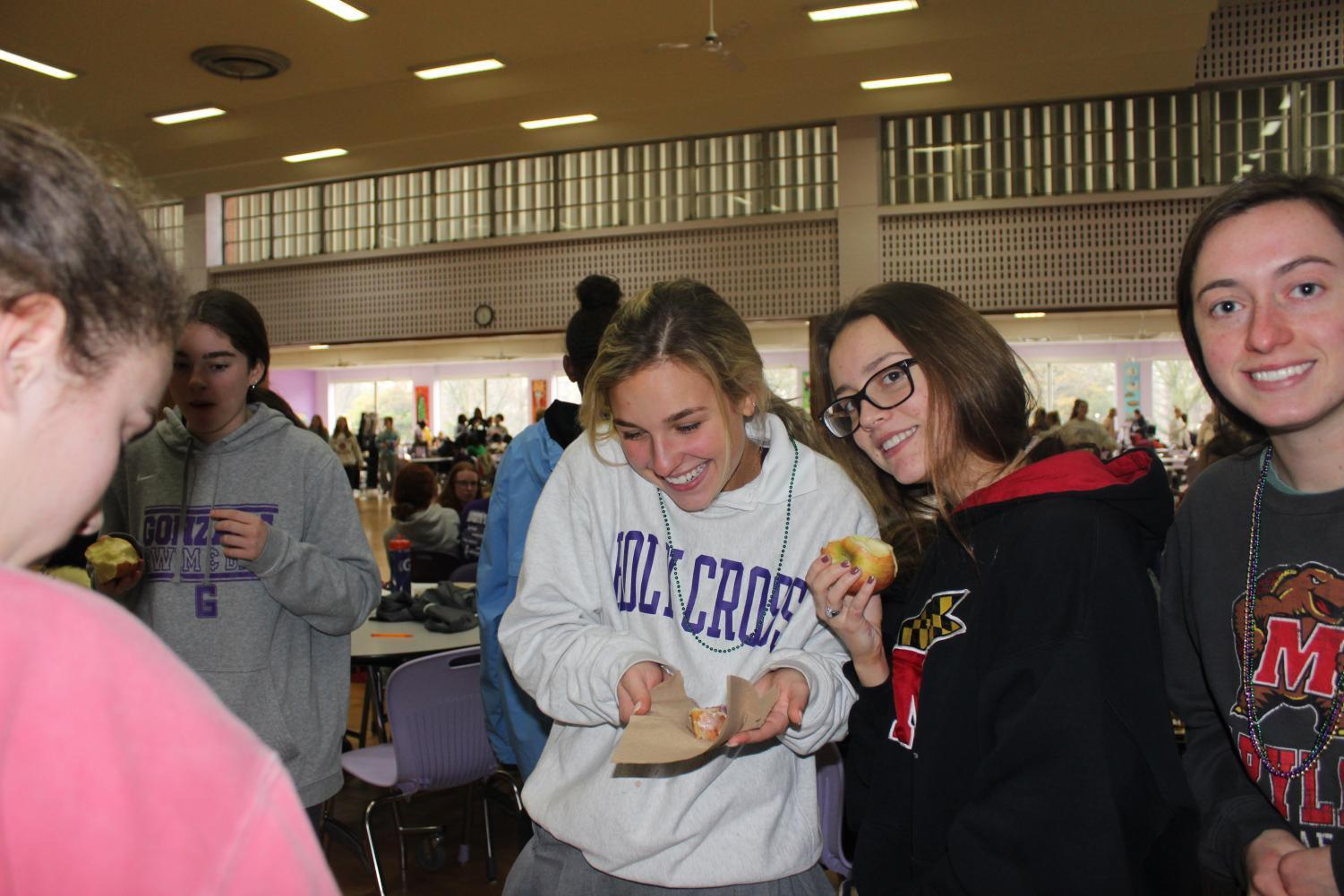 Kate Cosgrove and Charlotte Whittier getting their King Cake