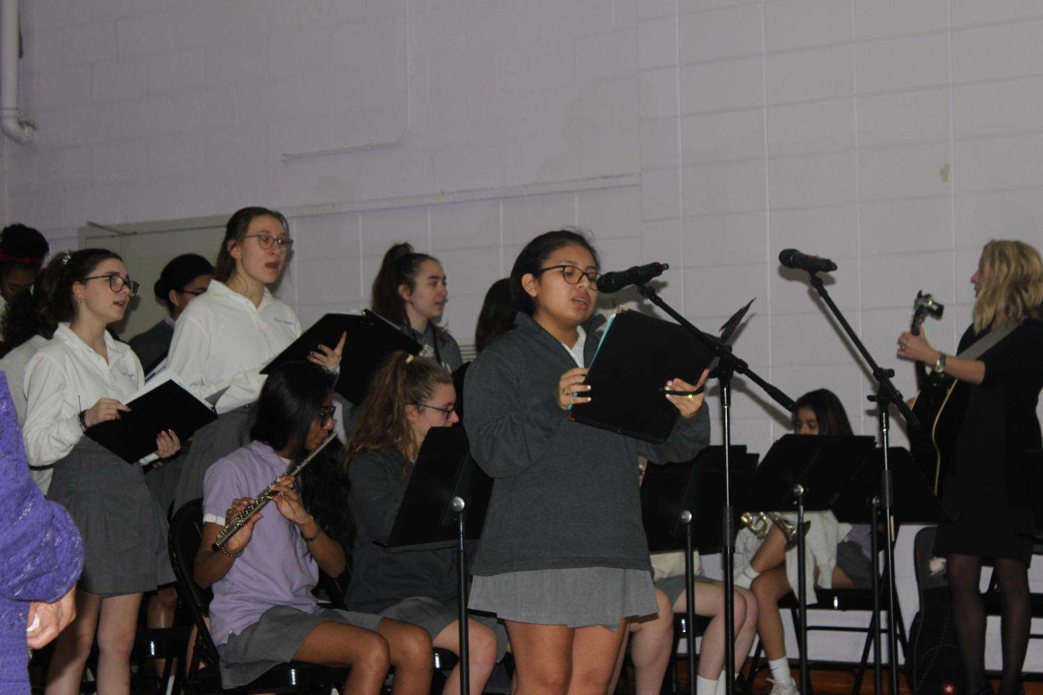 The choir singing at Ash Wednesday Mass