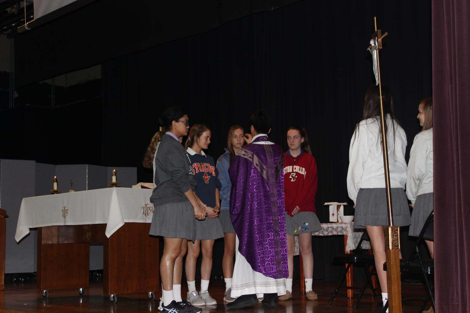 Eucharistic ministers get their ashes from Father Choi
