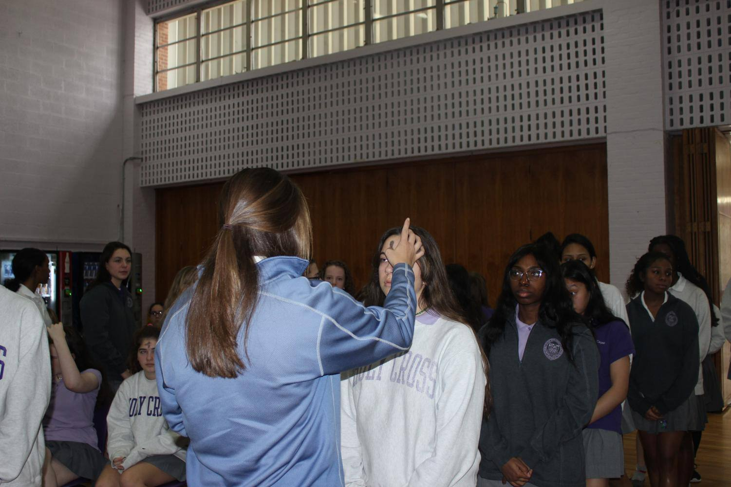 Students get their ashes during mass