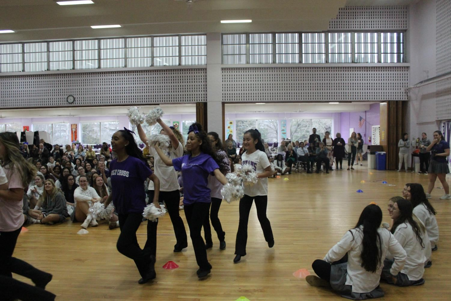 Poms team being cheered on at the pep rally.