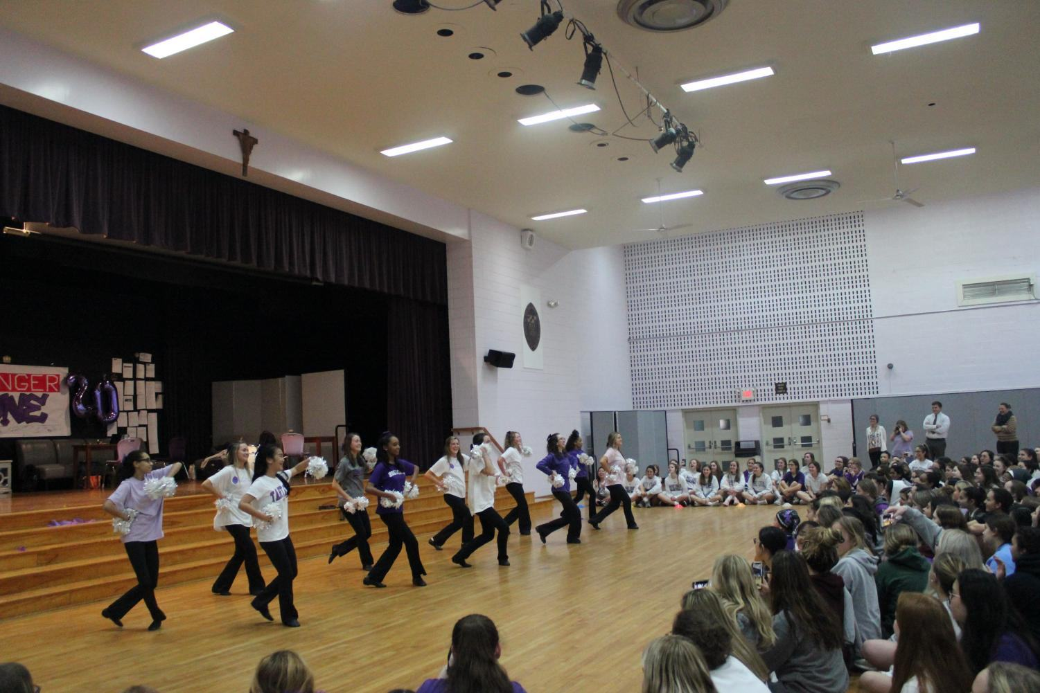 Poms performing a routine at the pep rally.