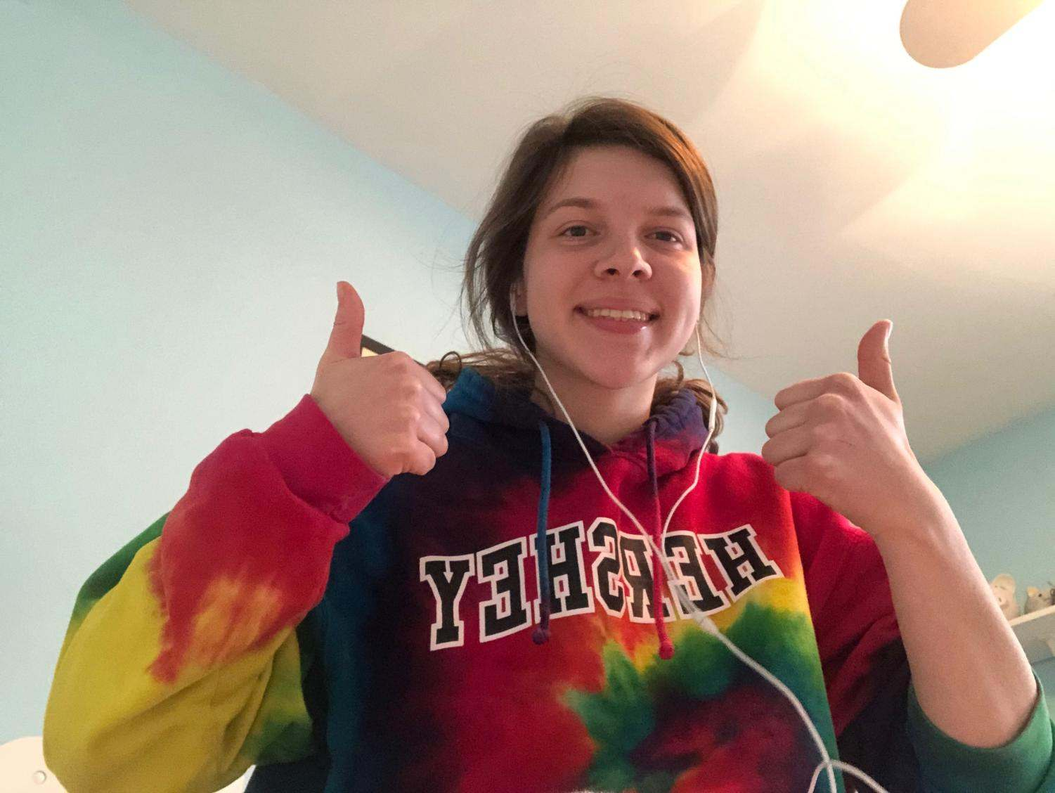 Senior Caitlin Bendit gives a thumbs up for working from home.