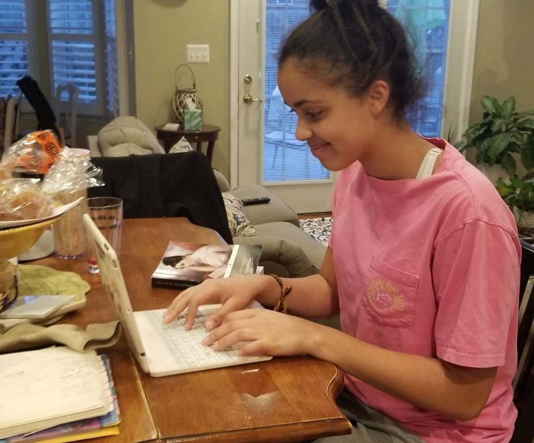 Sophomore Sophia Skinner working hard for her English class from home.
