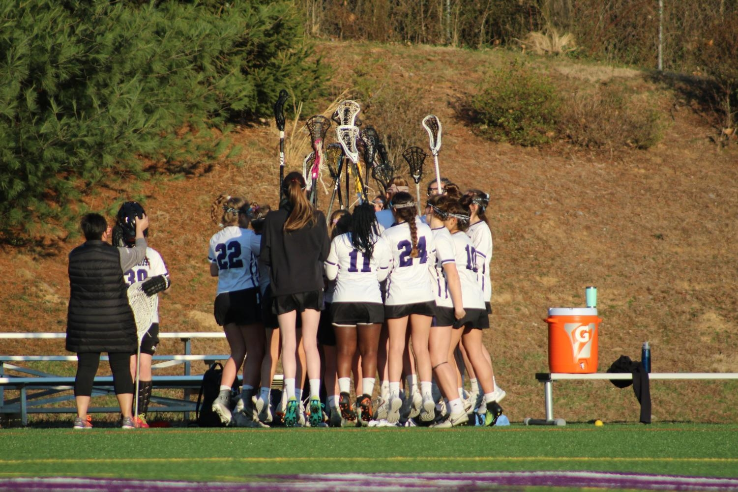 JV Lacrosse cheers together before their game against Holton-Arms.