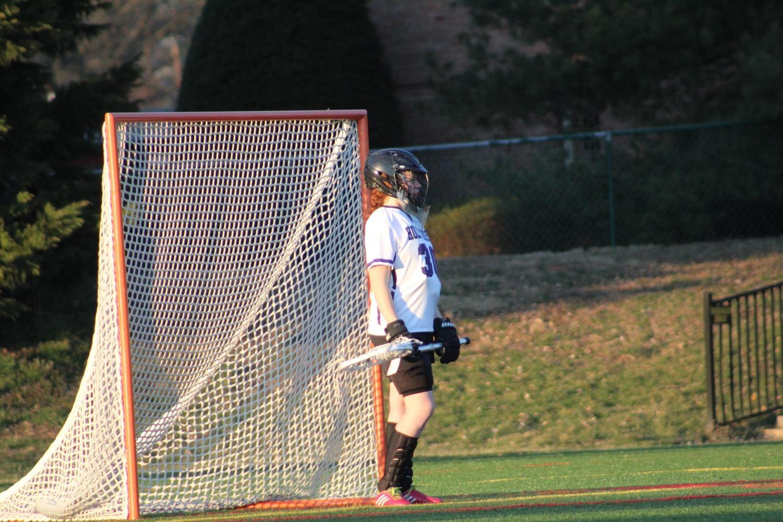 Freshman Sarah Owens in goal.