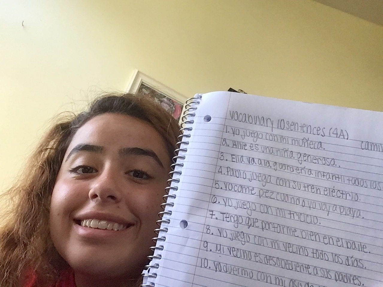 Sophomore Camilla Karns smiling wide while doing Spanish work.
