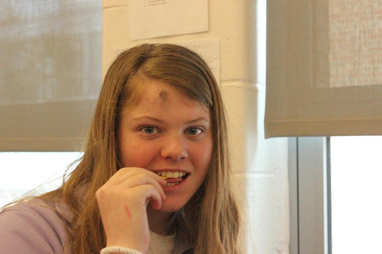 Sophmore Shannon Gibbons enjoying a snack on Ash Wednesday