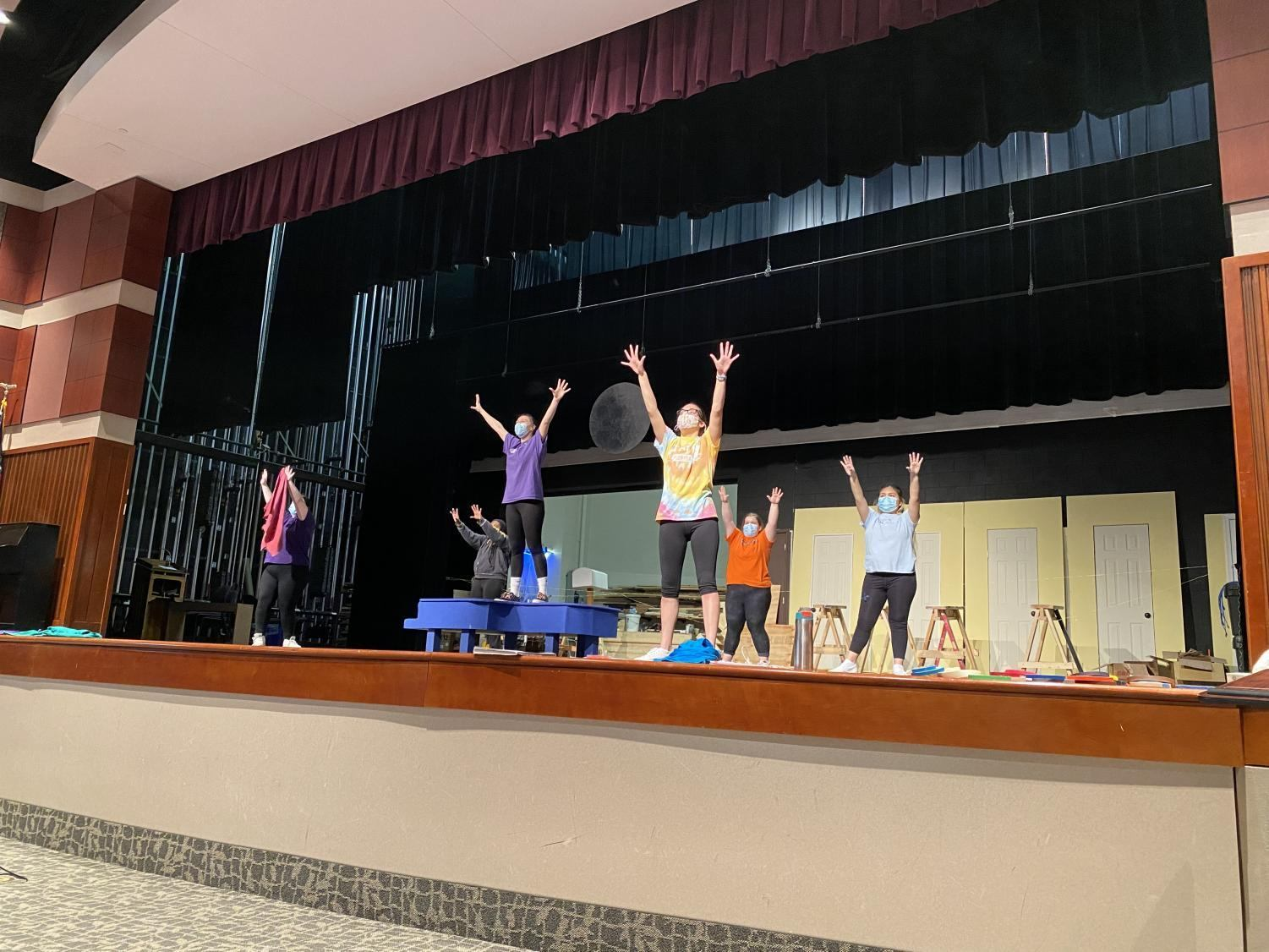 Actors in the theater practicing for You're a Good Man Charlie Brown