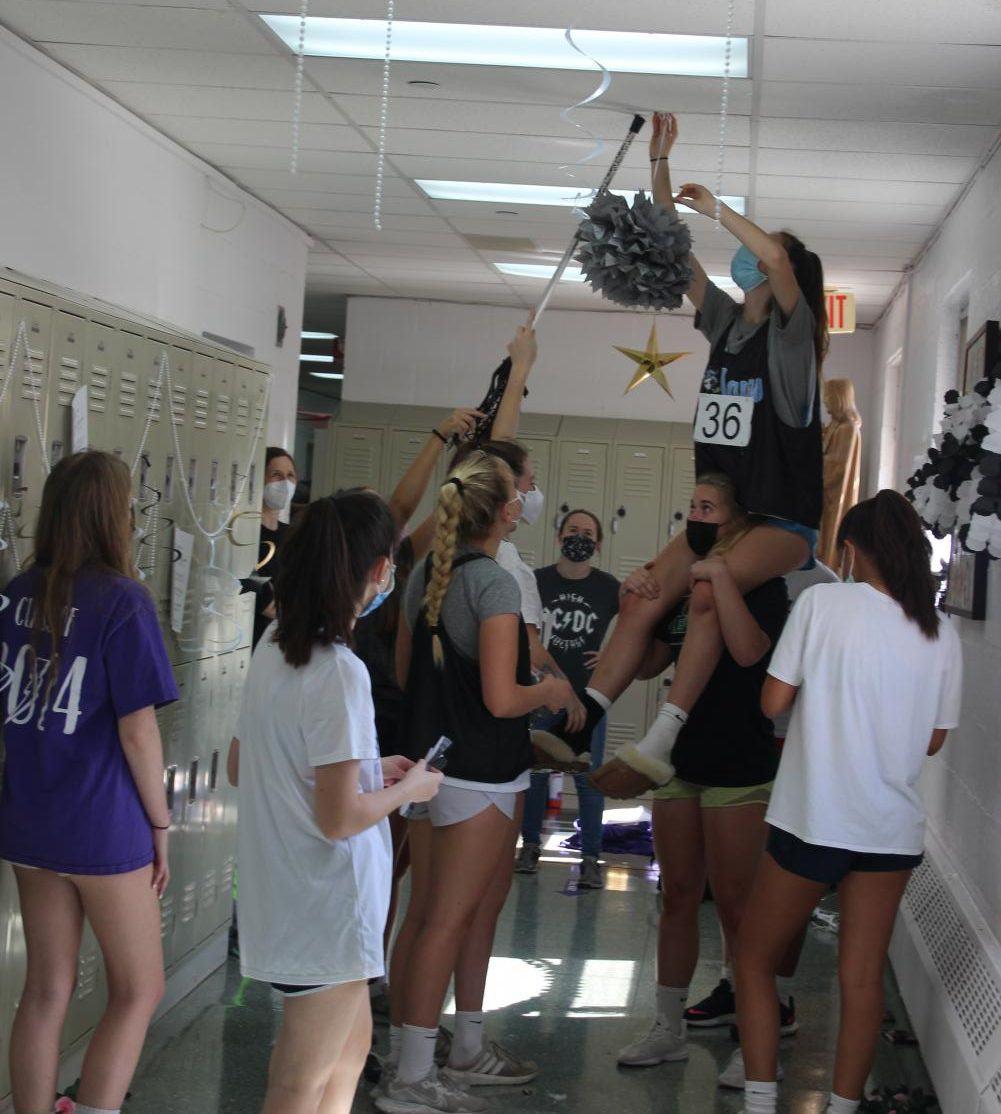 Freshmen decorating the Classical Music hallway for Spirit Week.