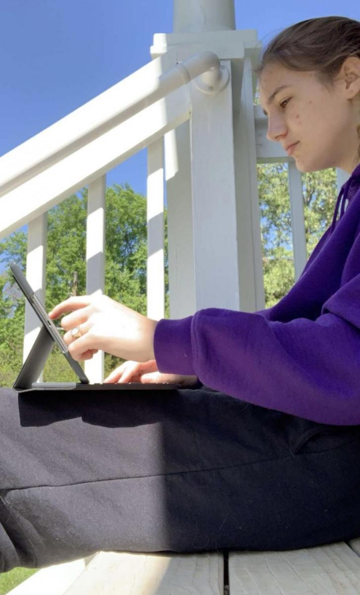 Evie Barnes doing some homework while enjoying the weather.