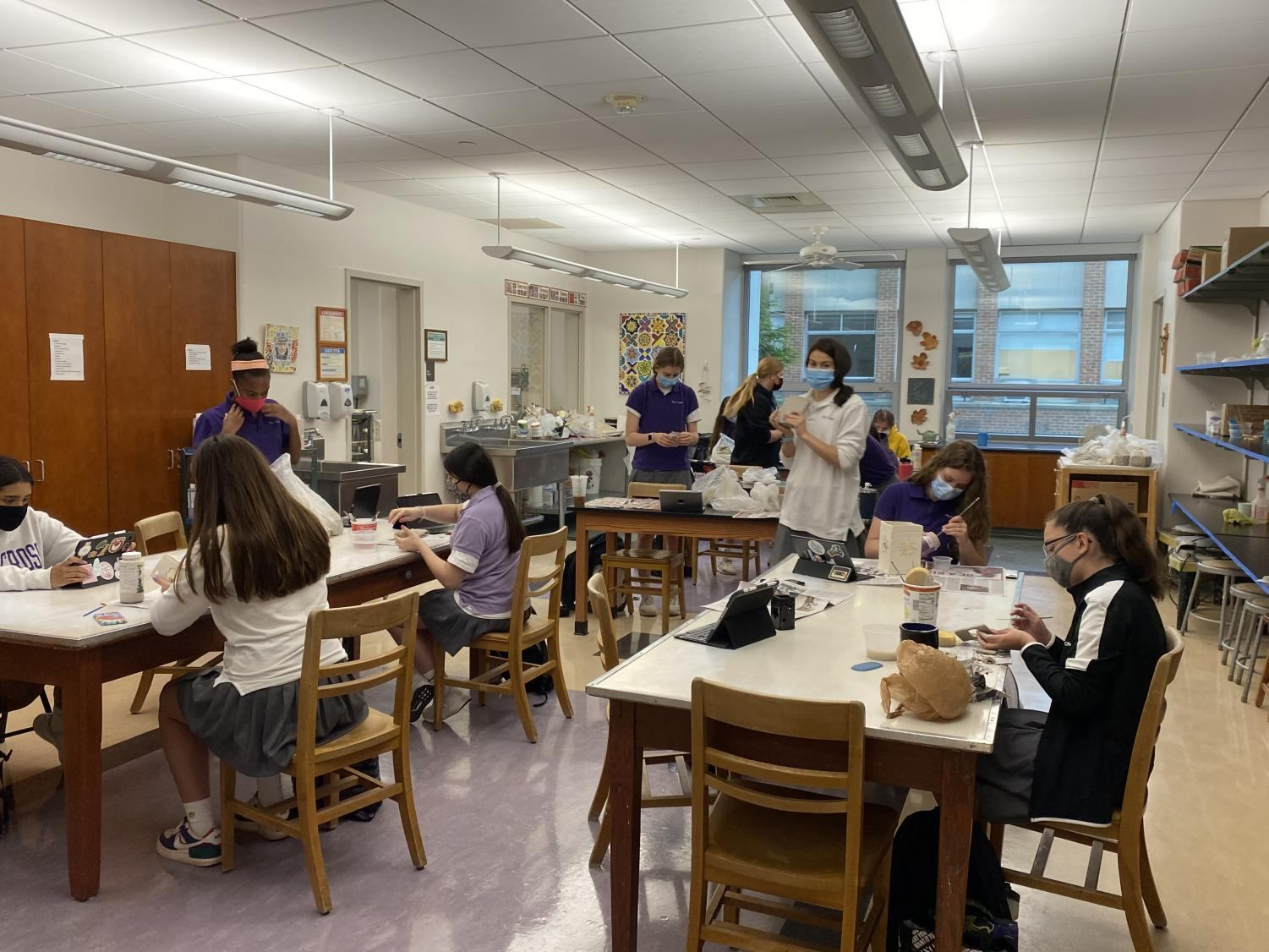 Students in ceramics working on their projects.