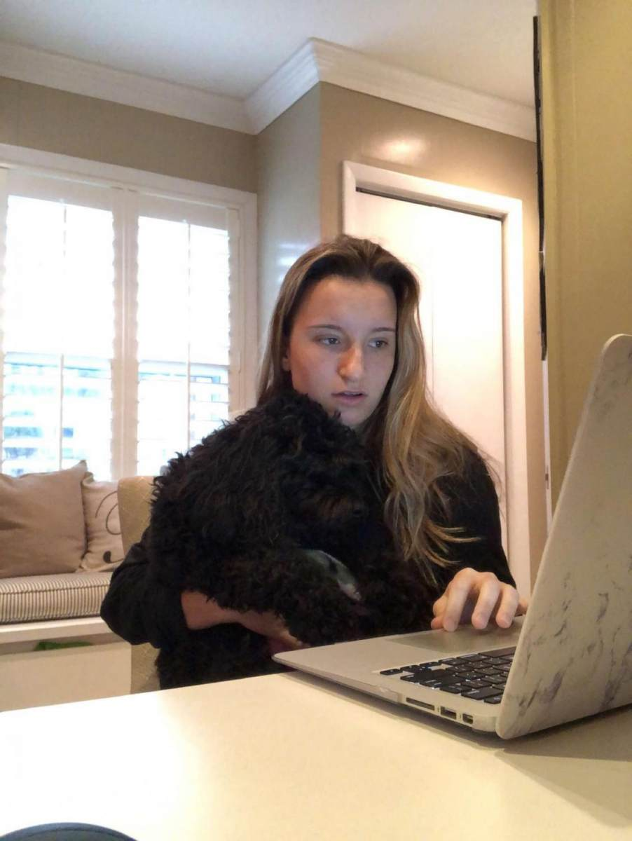Junior Chloe Rickerby is studying hard with the help of her dog.