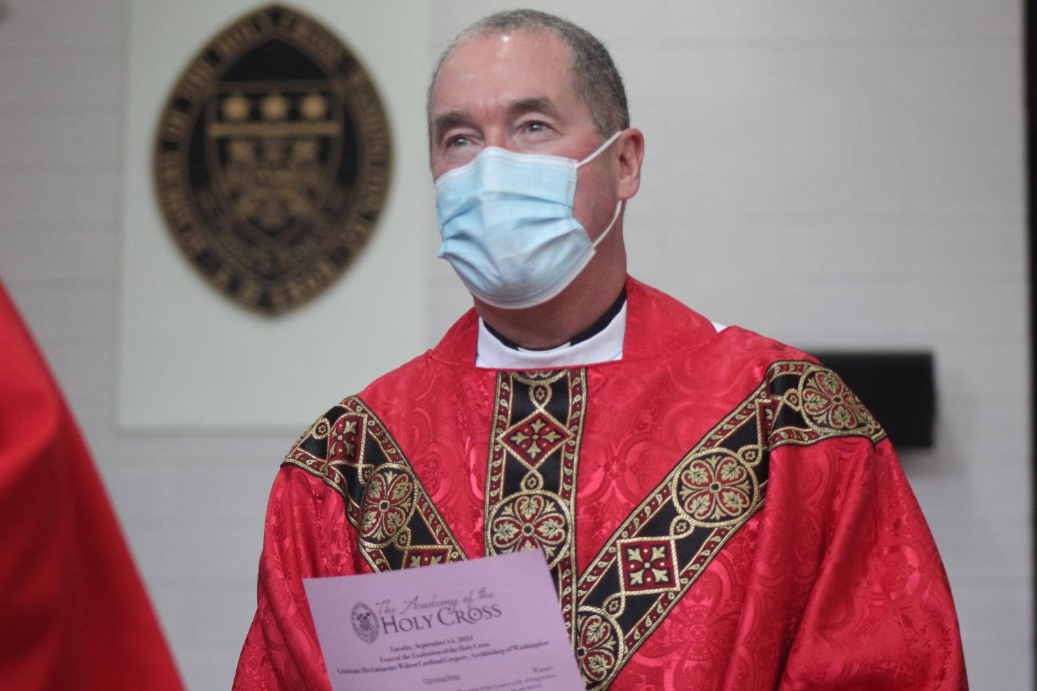 Father Van Dyke walking down the aisle at the end of Mass.