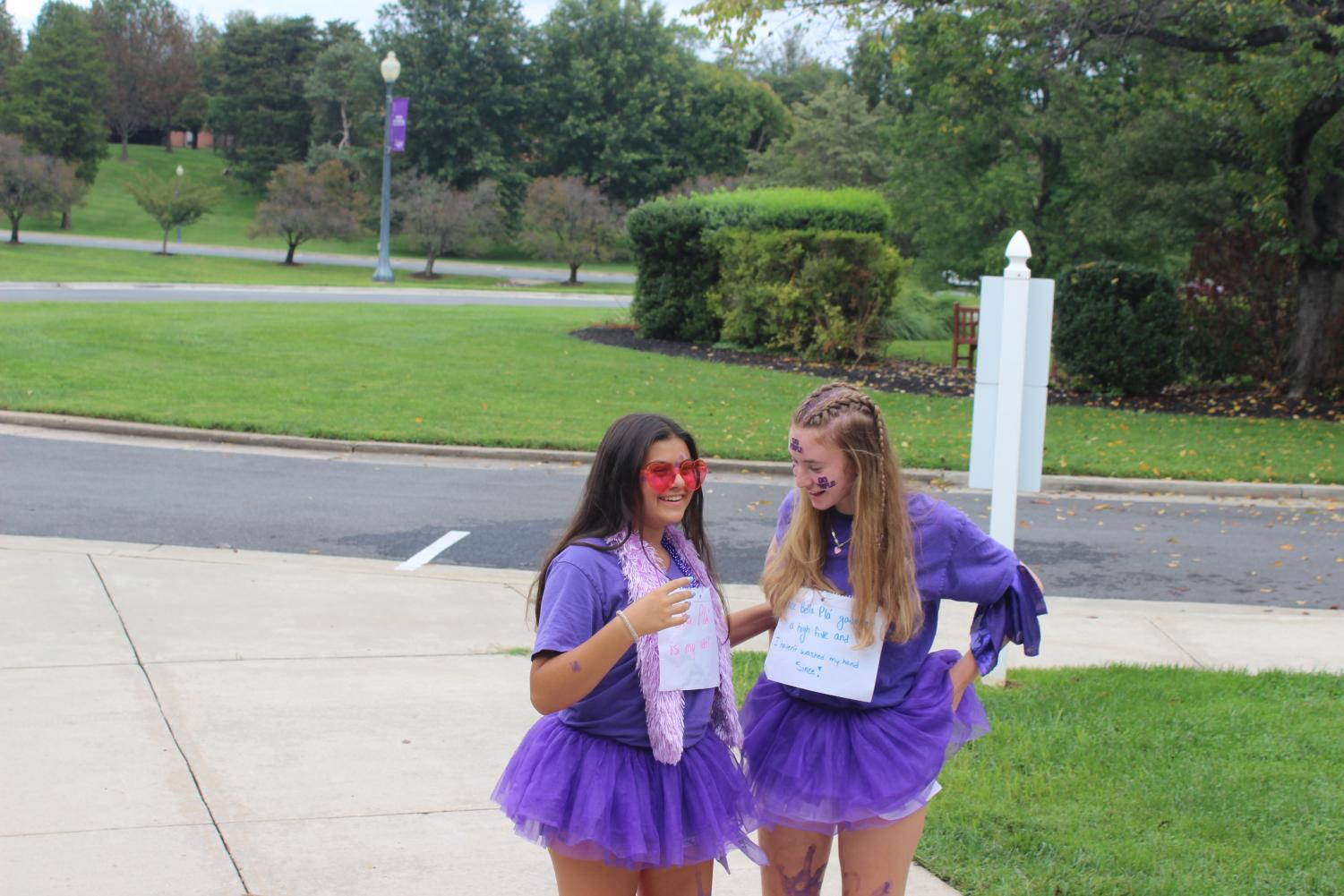 Alexia Sandonas and Anna Giacomini posing for a photo in their purple outfits for Holy Cross Day.