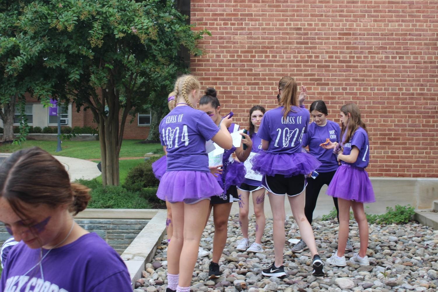 Sophomores taking pictures with their purple outfits before the HC Day events.