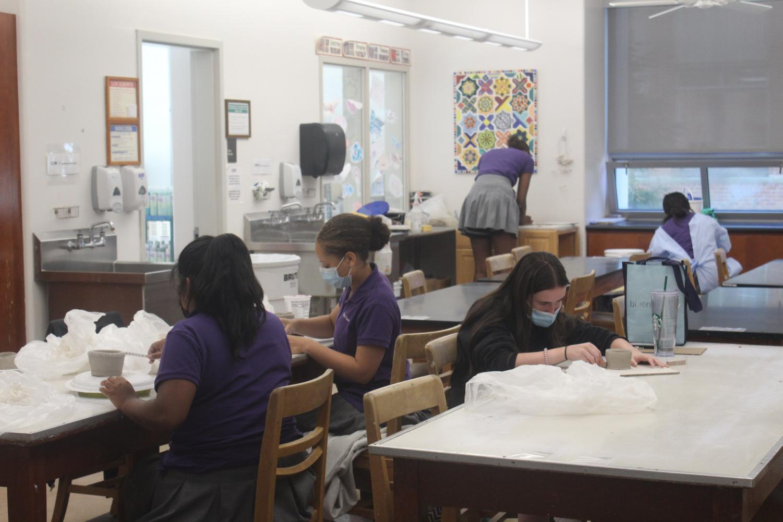 Students working in ceramics