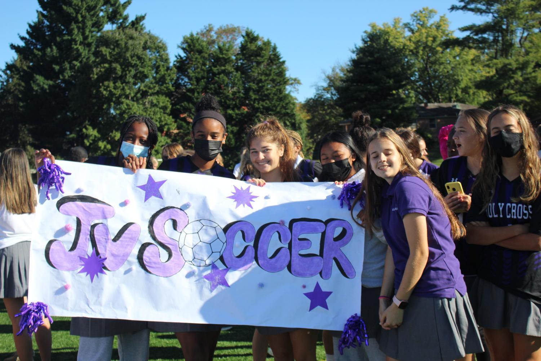 JV Soccer team holding up their amazing banner.