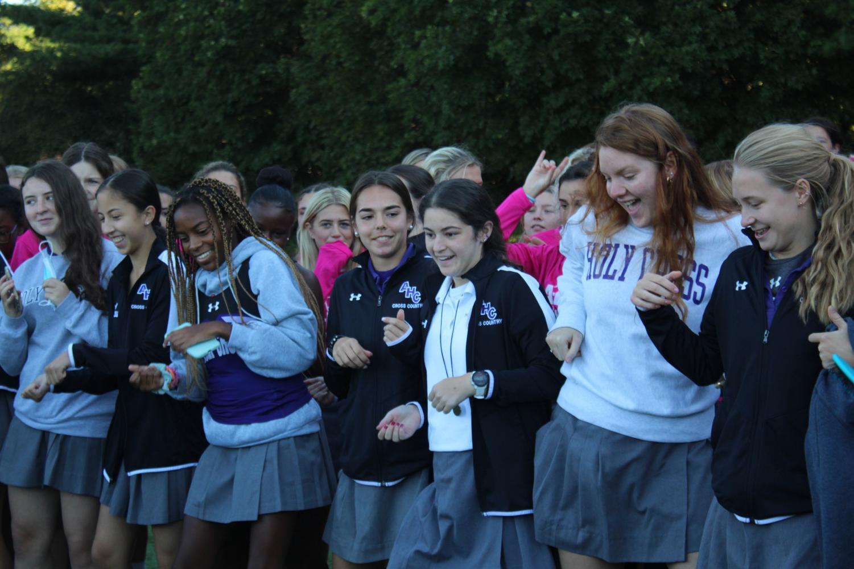 Fall sports team dancing.