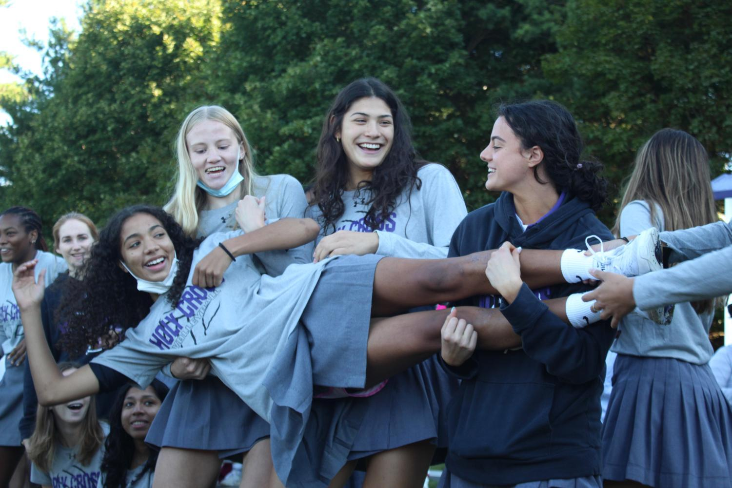 Volleyball team having fun at the pep rally.