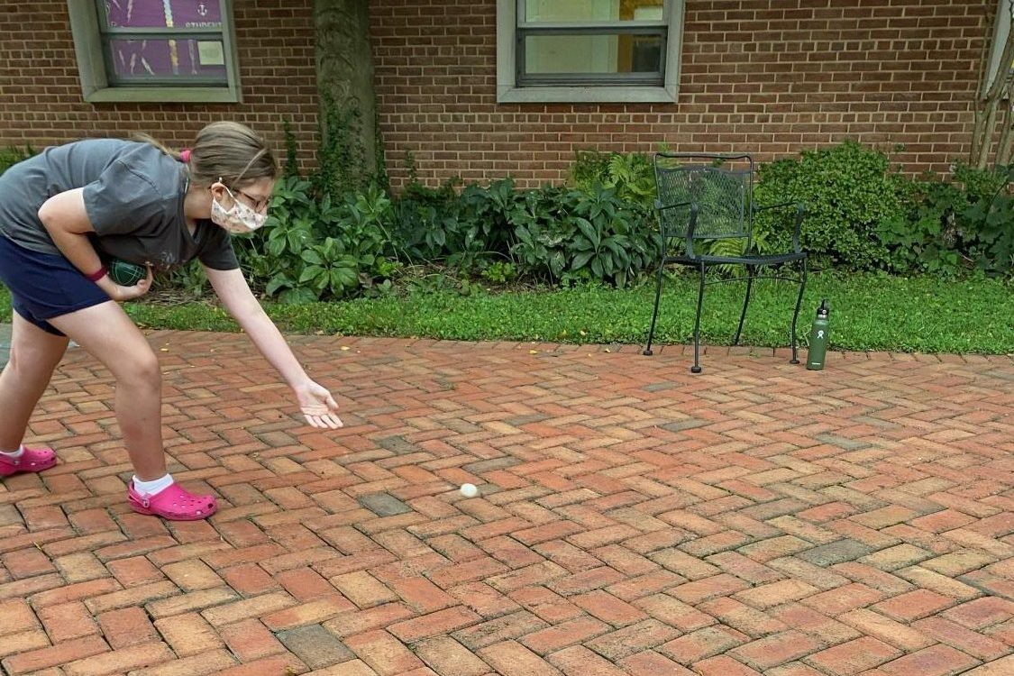 Sophomore Lucy Harris practices throwing the pallino.