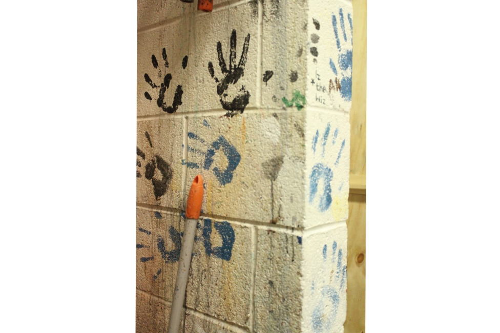 Hand Prints in Paint on the Wall in Shop
