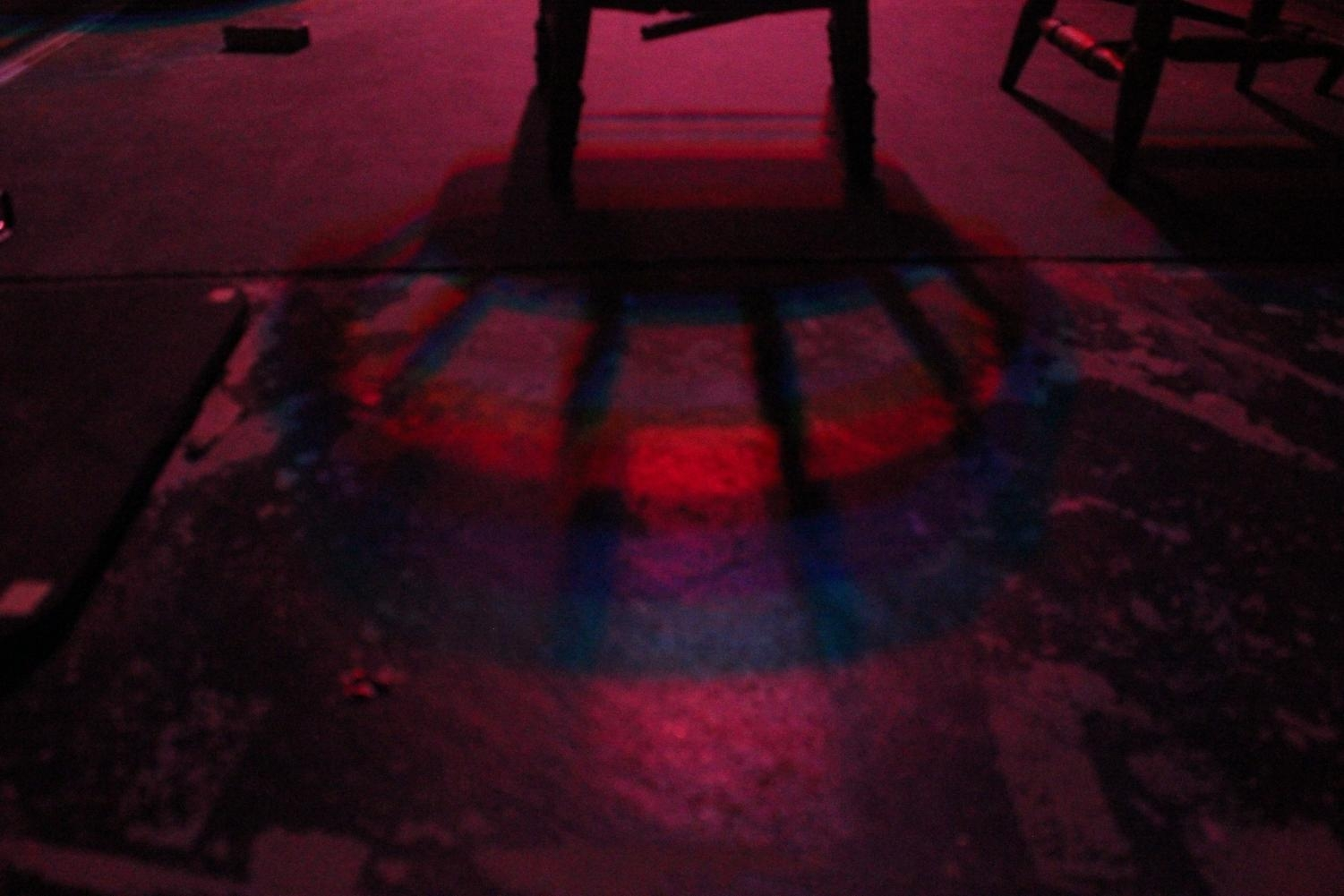 A Rainbow Shadow from a Chair Backstage