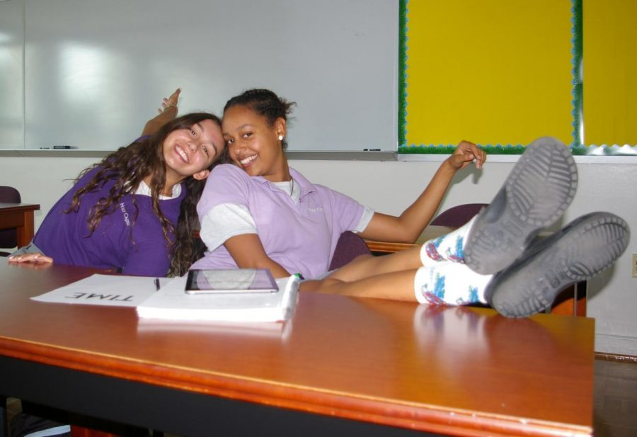 Juniors Beza Solomon and Lauren Kosiorowski take a break from completing work during their study hall period.