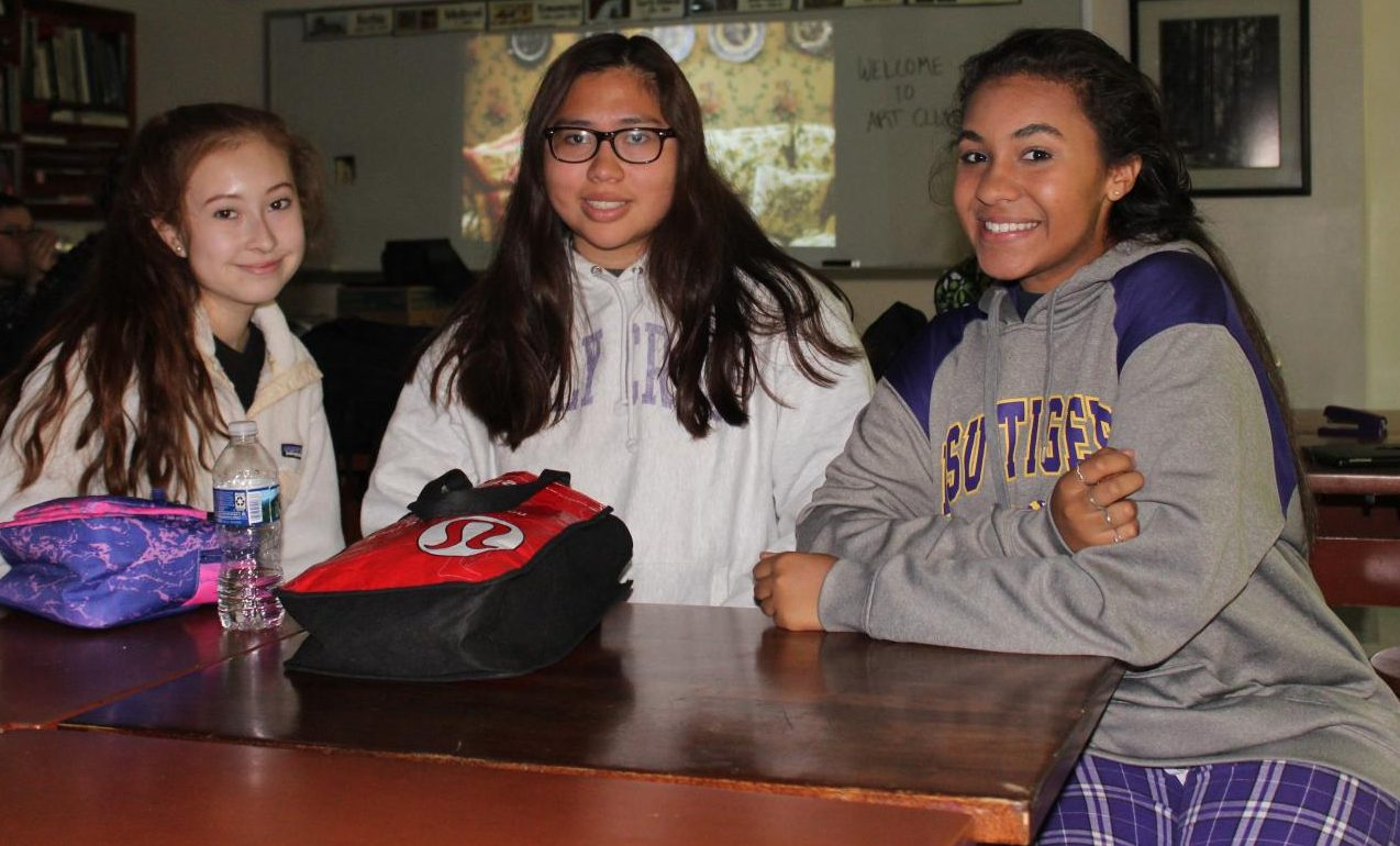 Juniors Christina Claverie, Marylin Caceres and Kaitlyn Menjijar, gathered together at an Art and Design meeting.