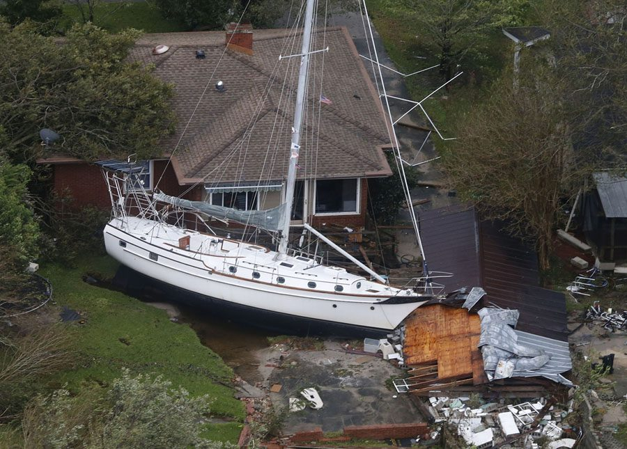 A+sailboat+is+shoved+up+against+a+house+and+a+collapsed+garage+Saturday%2C+Sept.+15%2C+2018%2C+after+heavy+wind+and+rain+from+Florence%2C+now+a+tropical+storm%2C+blew+through+New+Bern%2C+N.C.+