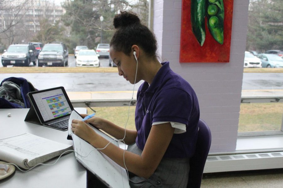 Sophomore Lynn Clough listening to music and getting a head start on homework