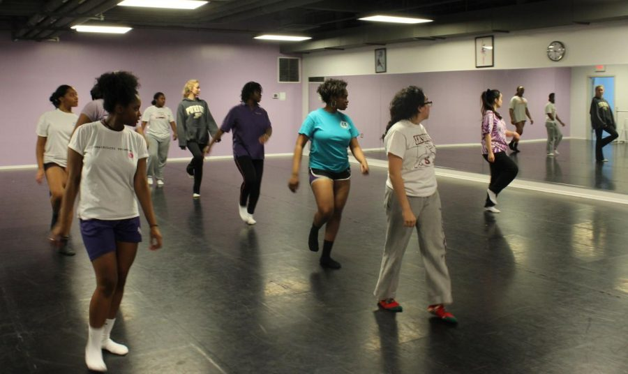 Hip-Hop Club practicing Ivy Peng's choreography to