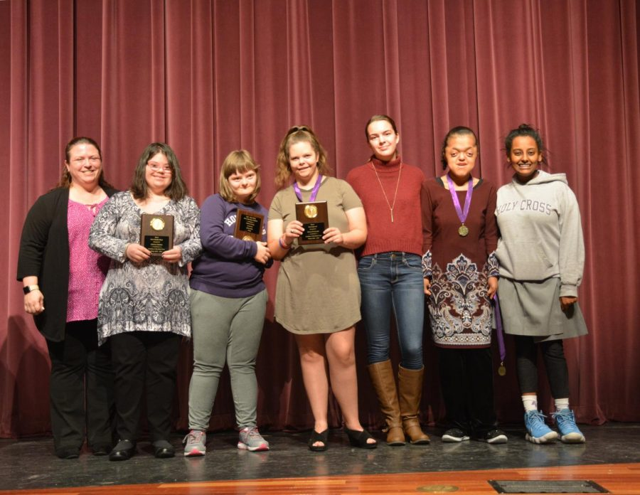 Bocce team smiling for the camera with their awards
